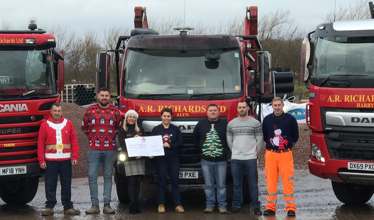 The staff of AR Richards presenting the money to the Midlands Air Ambulance