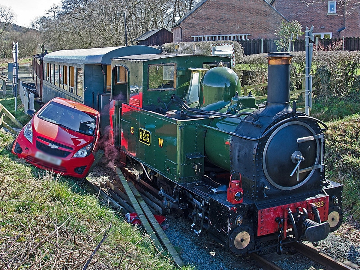 Heritage railway train and car in level crossing crash
