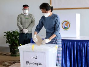 Aung San Suu Kyi casts her ballot in last year's election