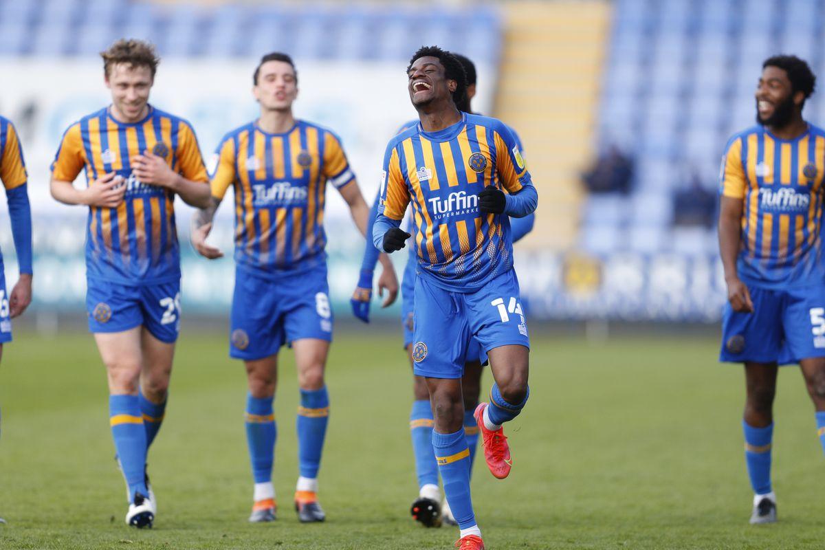 Nathanael Ogbeta of Shrewsbury Town celebrates after scoring a goal to make it 3-0.