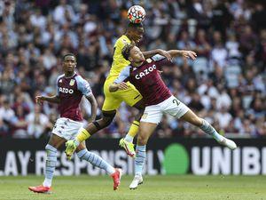 Brentford's Ivan Toney (centre) and Aston Villa's Matty Cash (right)