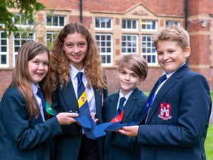 Year 7 pupils showing off the new Bridgnorth Endowed School house ties that will be introduced this September