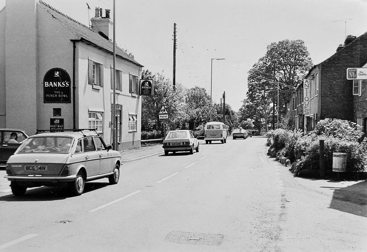 West Felton was anything but a quiet backwater village 40 years ago as this photo shows, with a constant stream of traffic going down the old A5. This picture was taken on May 26, 1981, with the Punch Bowl pub on the left, and an antiques shop on the right of the busy road.