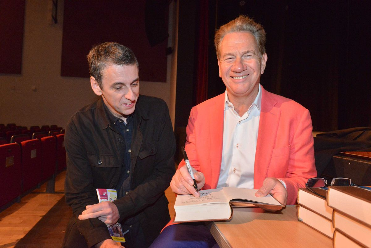 Michael Portillo signing one of his books for fan David Ravenscroft