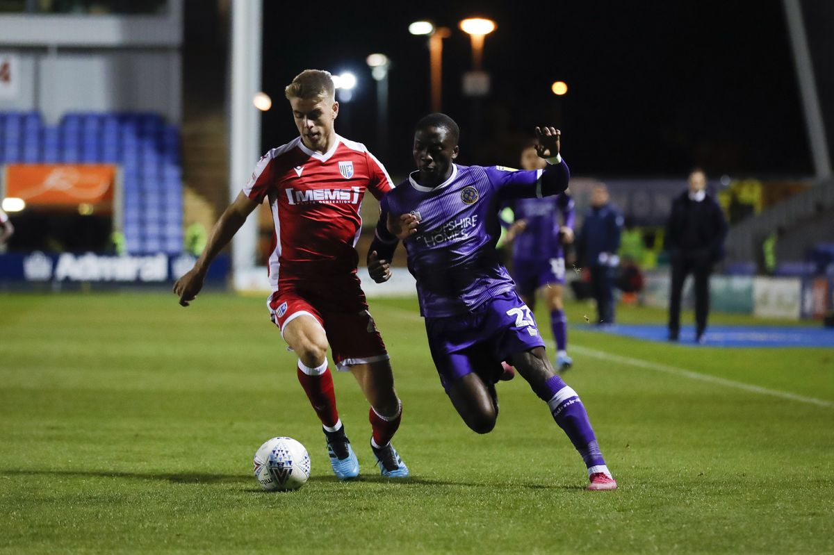 Jack Tucker and Daniel Udoh tussle for the ball