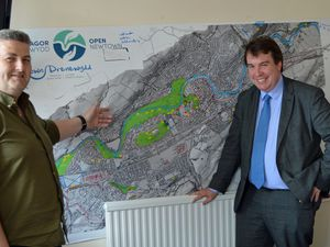 Montgomeryshire MP is shown a map of Newtown's green spaces by Stuart Owen and Adam Kennerley from Open Newtown.