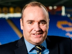Shrewsbury Town chief executive Brian Caldwell delighted to reach safe-standing target