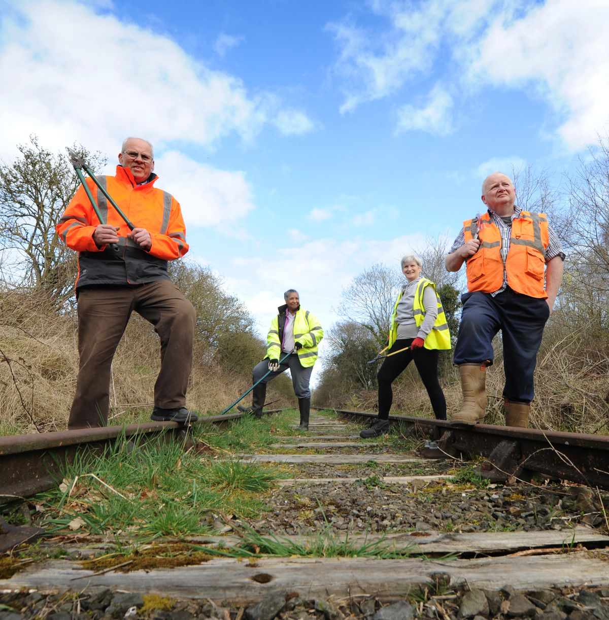 Working on the railway line, are volunteers, Nick Culliford, Joanne Knight, Anne Boden, and Norman Knight