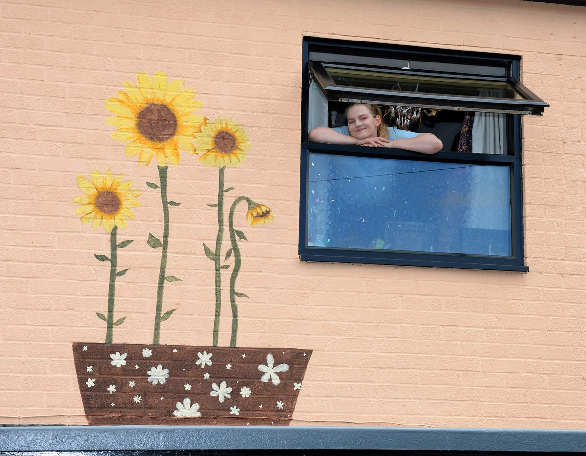 Alana also painted some sunflowers on the wall at the rear of the house