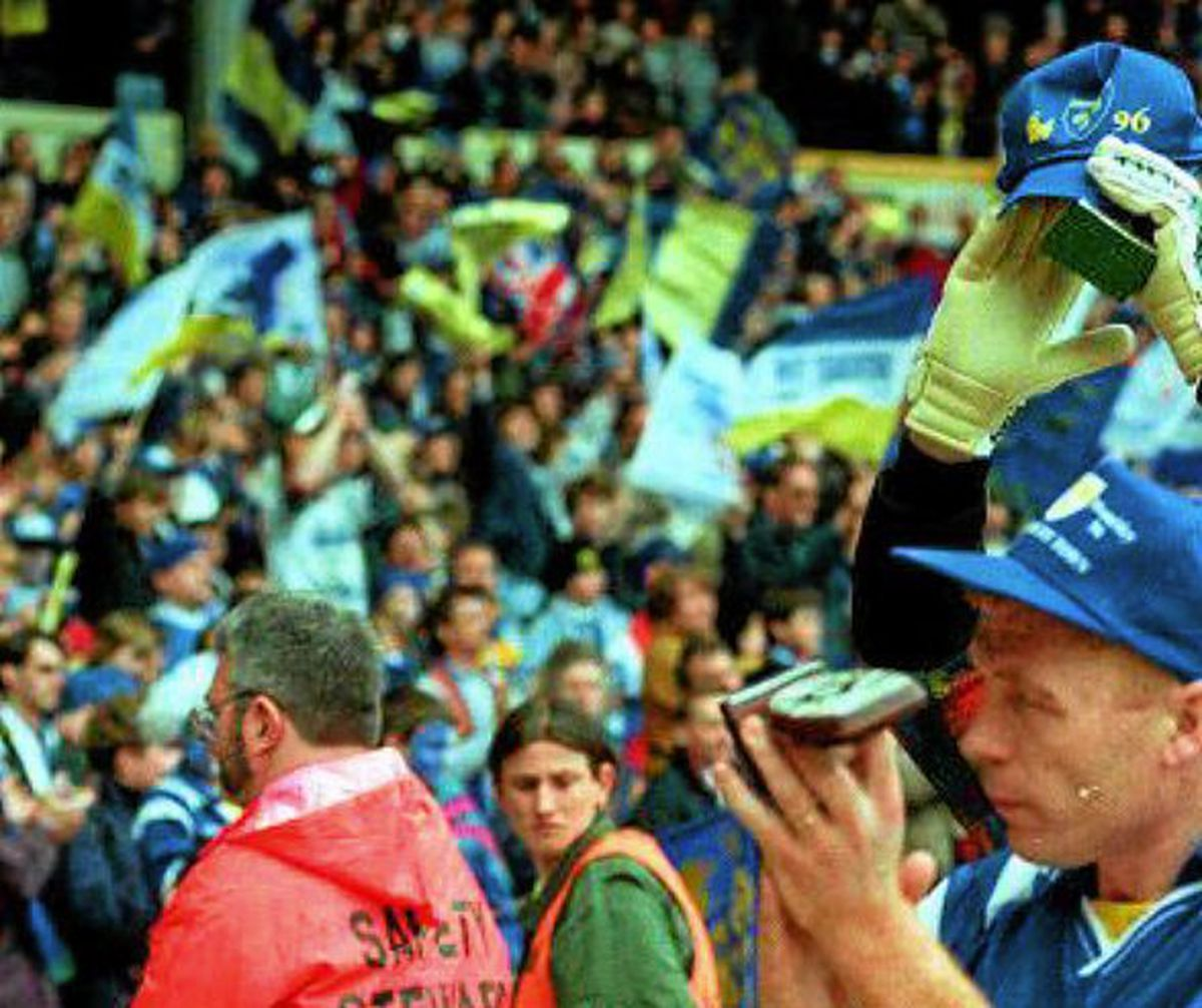 Fans' favourite Tommy Lynch saluting Shrewsbury Town fans at Wembley after the 1996 defeat