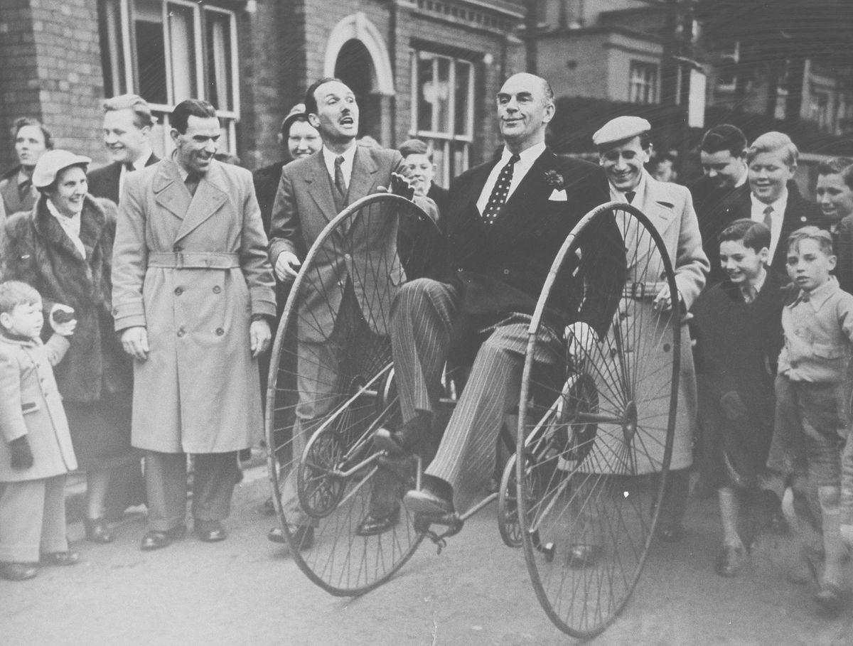 George, on the left, with moustache and tie, watches as the famous broadcaster Kenneth Horne tries out an unusual form of transport in Tan Bank, Wellington. The occasion was the launching of a cycling proficiency scheme in the 1950s – George was at the time chairman of the road safety committee of Wellington Urban District Council.