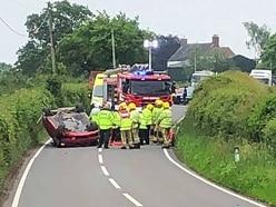 Elderly woman taken to hospital after car rolls on to roof near Market Drayton