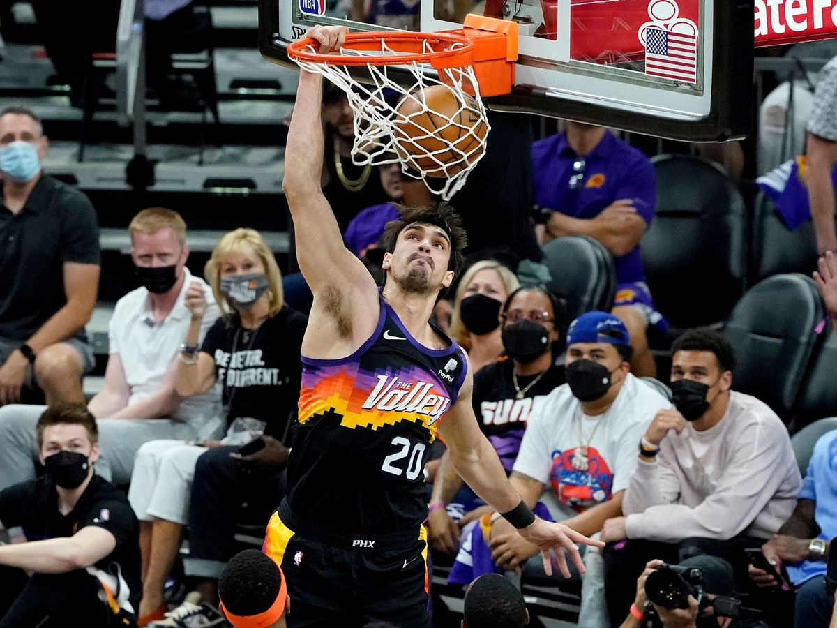 Phoenix Suns forward Dario Saric dunks against the Denver Nuggets during the first half