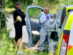 Sadness tinged with relief as human remains found in search for Judy Fox