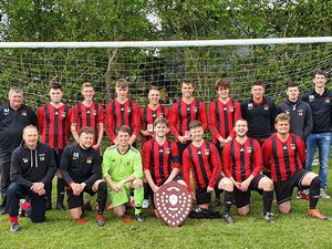 Stars in stripes – Clee Hill United proudly show off their Herefordshire League trophy
