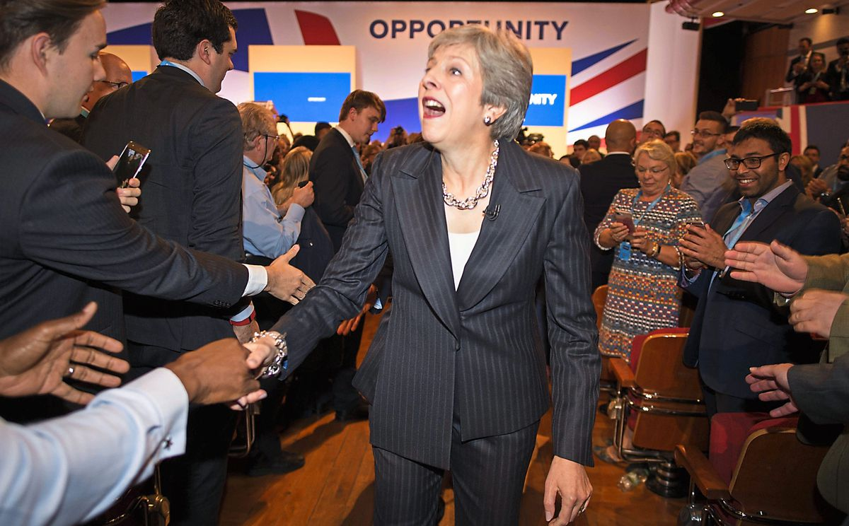 Theresa May and her husband Philip meet supporters after delivering her keynote speech