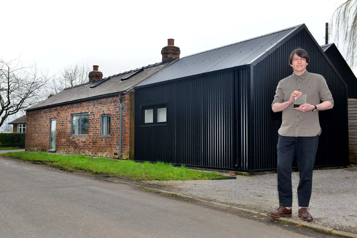 Philip Handley from Studio Bloc outside his award-winning family home in Whixall