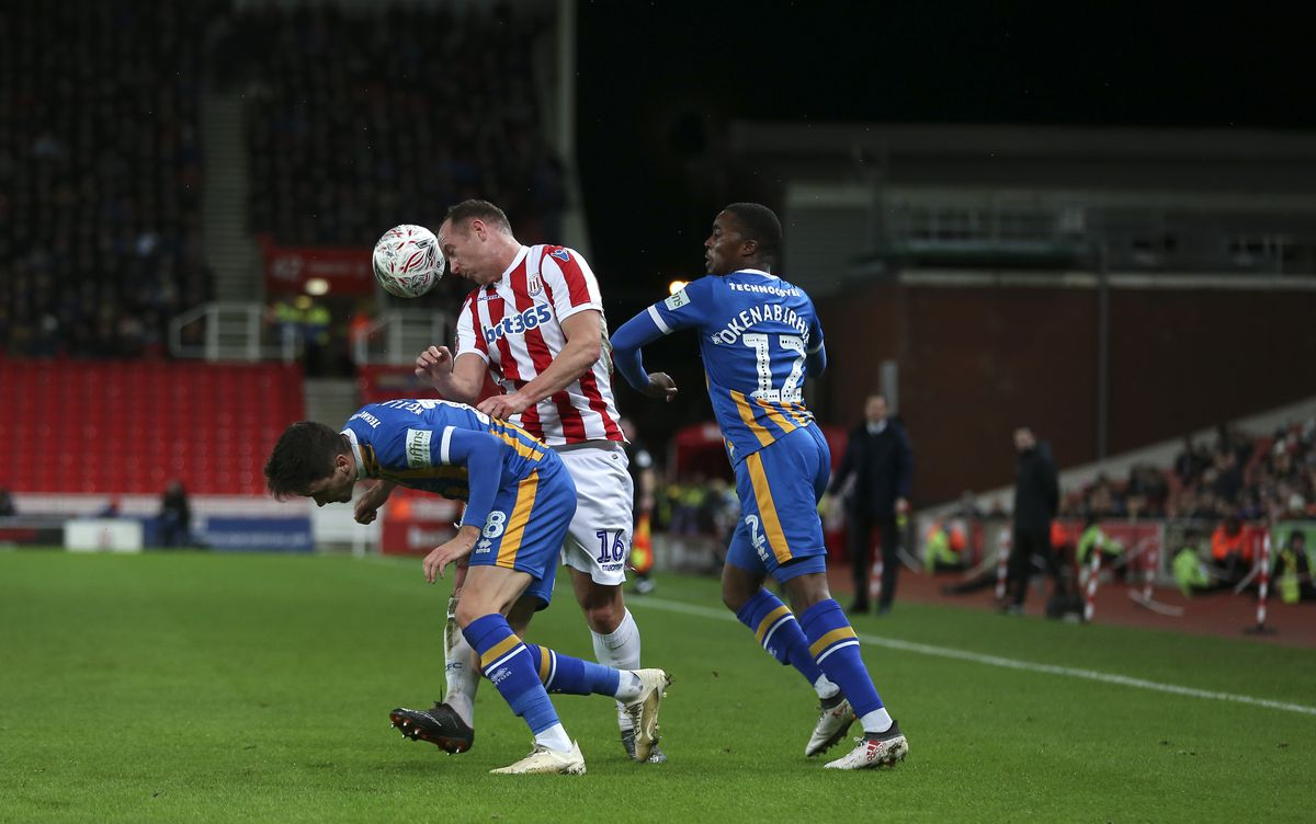 Alex Gilliead and Fejiri Okenabirhie of Shrewsbury Town challenge Charlie Adam of Stoke City. (AMA)