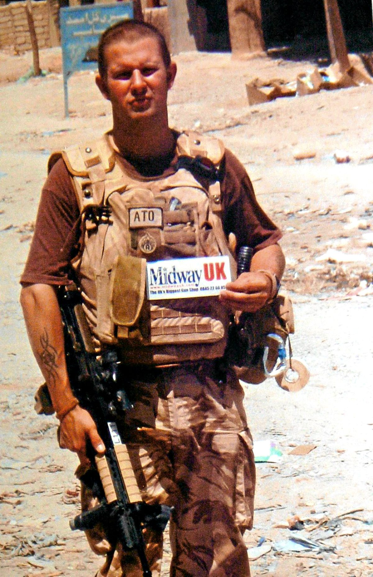 Staff Sergeant Kim Hughes on duty in Afghanistan, where he diffused bombs