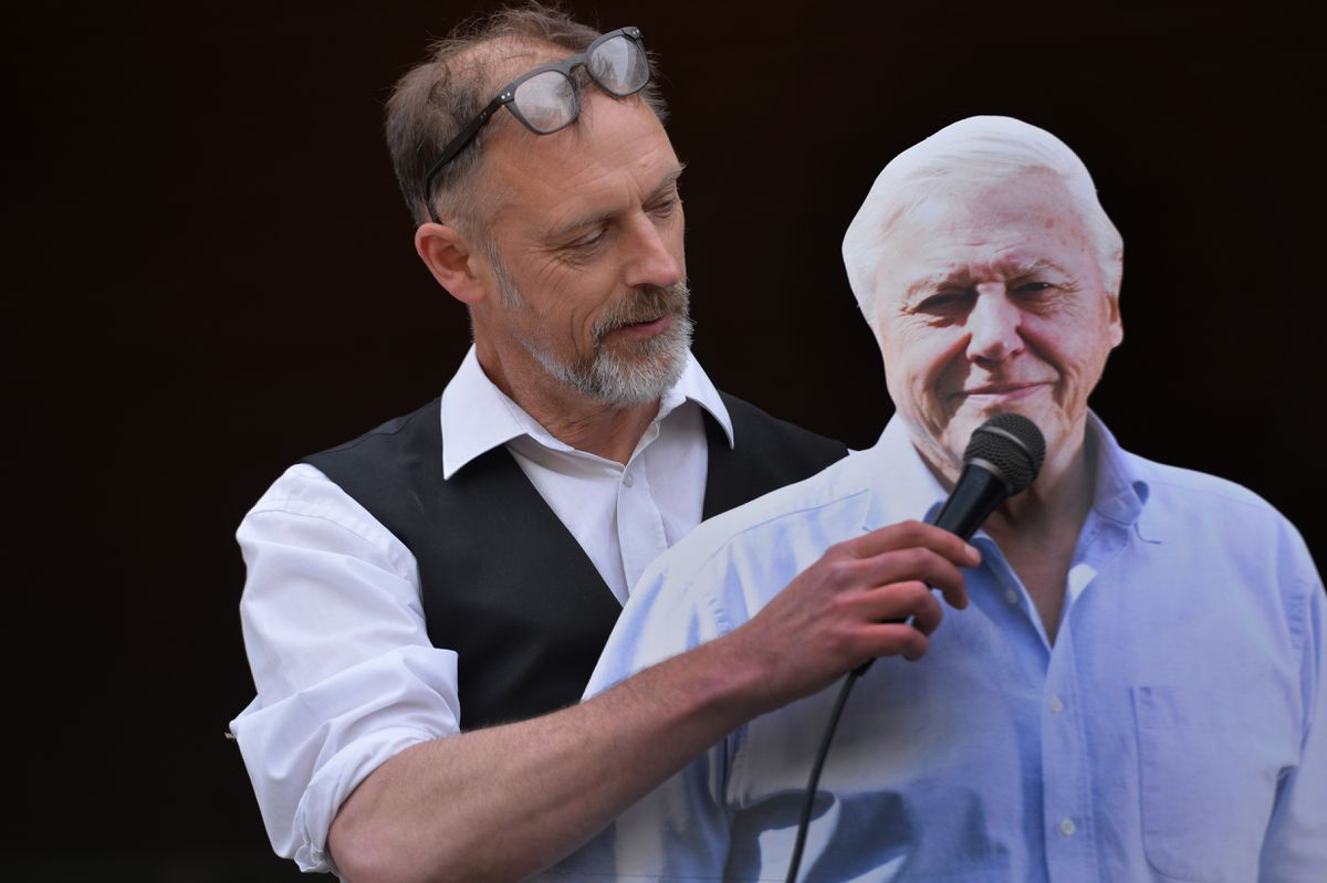 Adam Shipp with a cardboard cut-out of naturalist and environmentalist David Attenborough