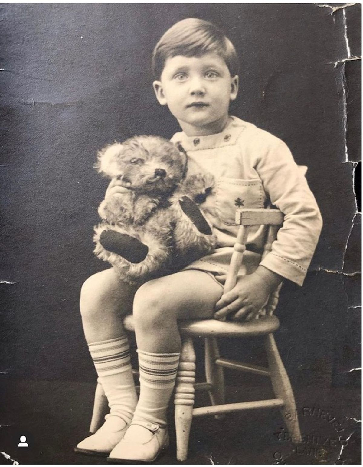 George Harwood in the same position as his grandfather, Alfred, with the same teddy bear - 86 years apart