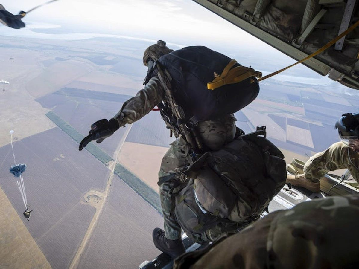 A member of the Pathfinders exiting the back of a Hercules C130 aircraft to parachute into Ukraine