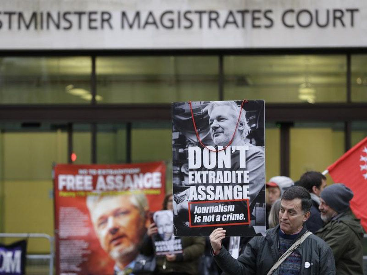 Demonstrators supporting Julian Assange outside Westminster Magistrates' Court