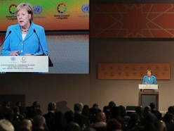 Angela Merkel urges respect for migrants in speech at UN conference