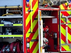 Woman trapped after car crashes into Shropshire house