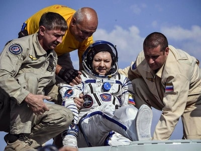 Space Station astronauts return to Earth
