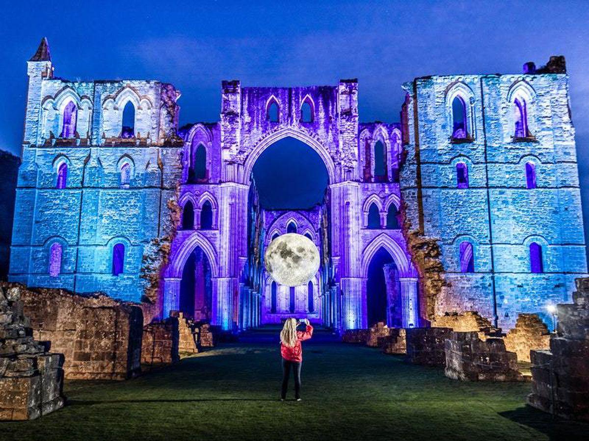 Luke Jerram's Museum of the Moon at English Heritage's Illuminating Rievaulx installation at Rievaulx Abbey, near Helmsley, North Yorkshire