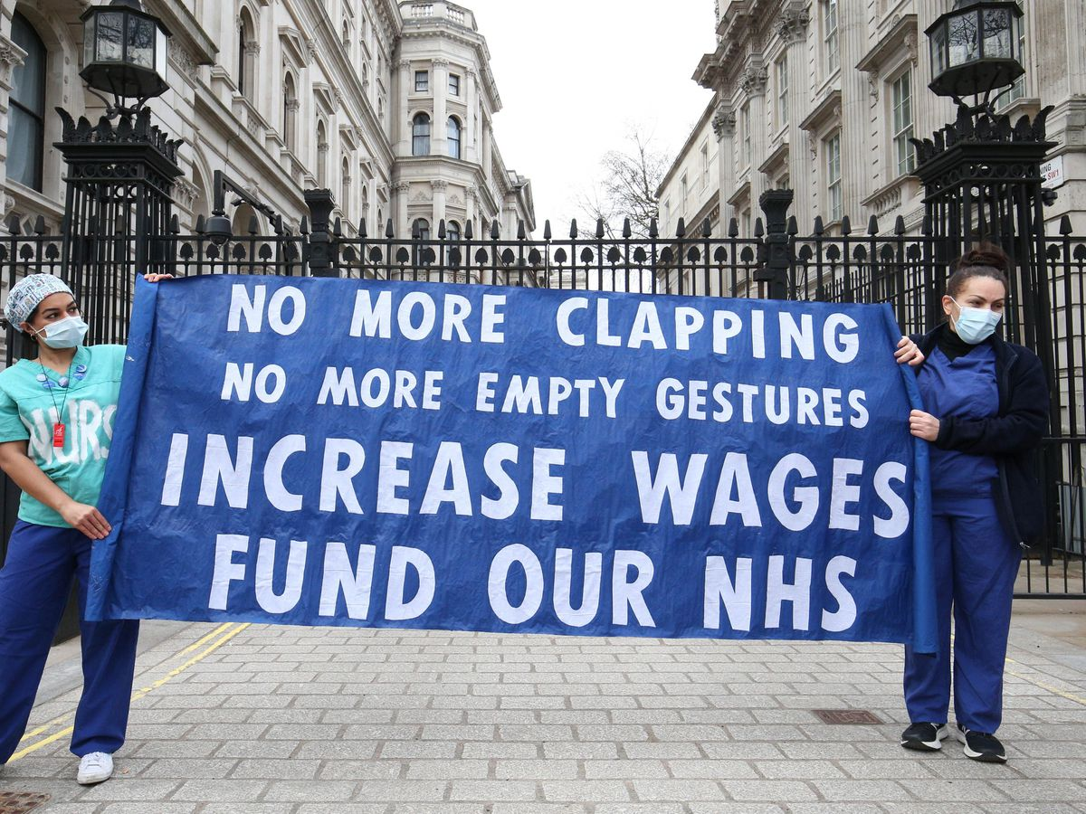 Nurses and NHS workers from the campaign group NHS Workers Say No, and Unite's Guys and St Thomas Hospital Union branch, hold a socially distanced protest outside Downing Street (