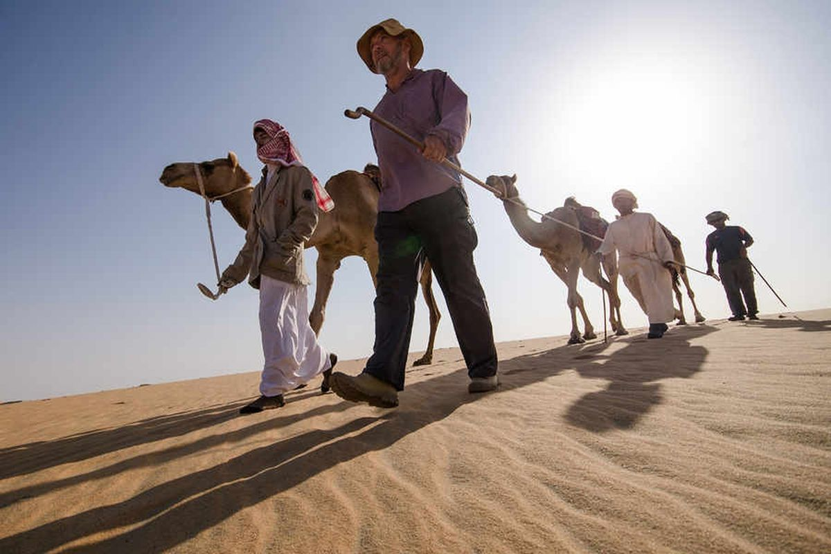 Mark Evans, centre, leading his expedition through the desert