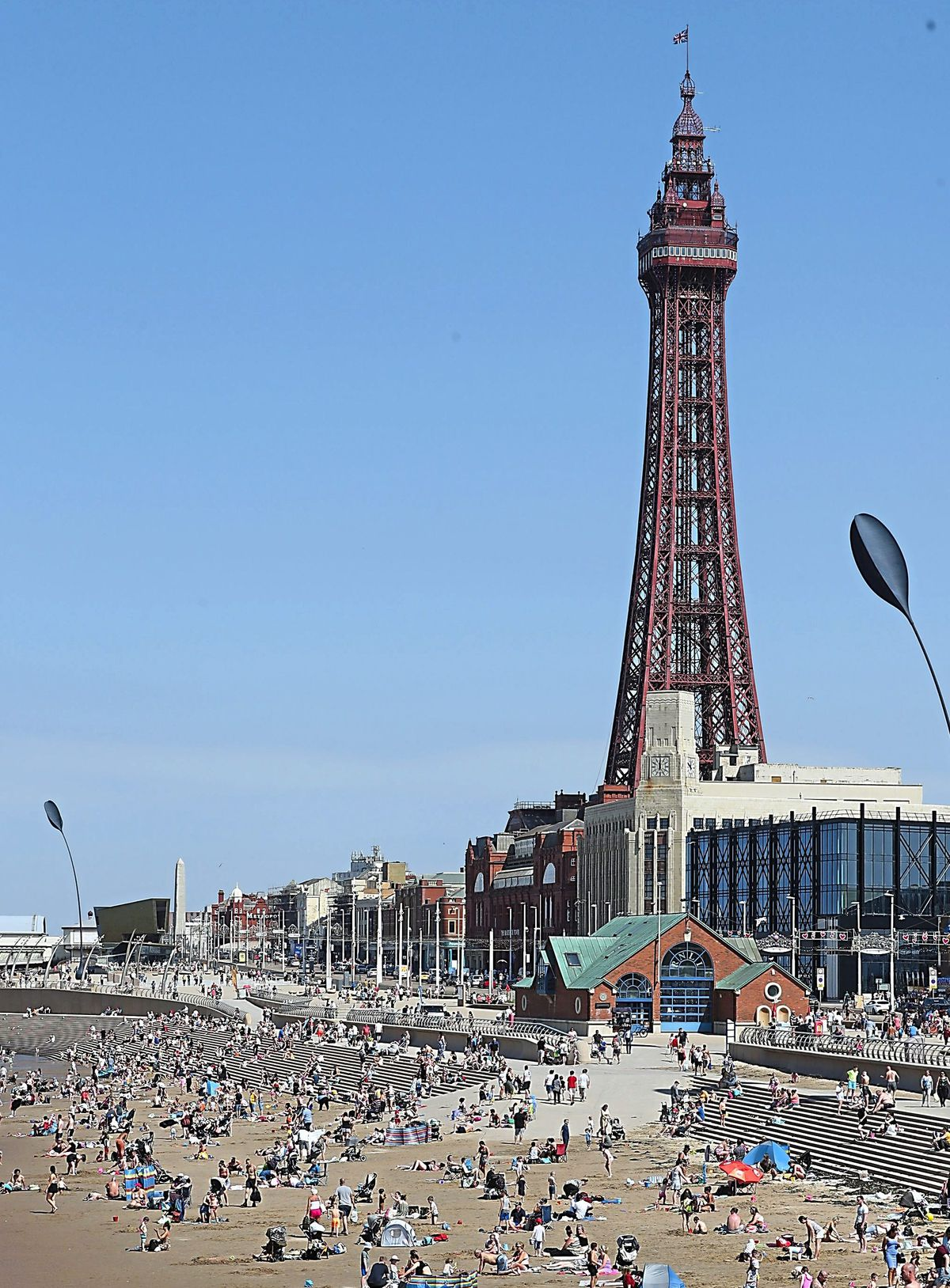 People enjoy the hot weather at Blackpool beach