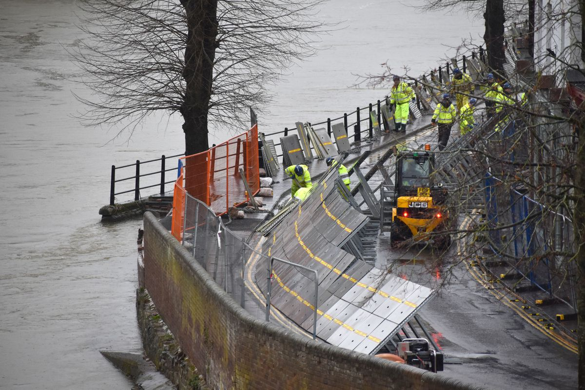 Environment Agency teams repair the temporary flood barriers in the Wharfage area of Ironbridge