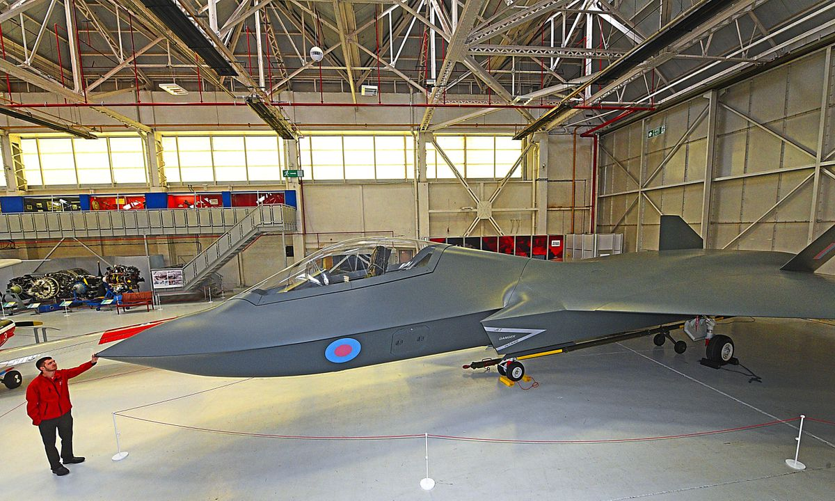 The futuristic concept aircraft Tempest, which is on display at RAF Cosford Museum. Pictured is visitor assistant Louis Cawkwell.