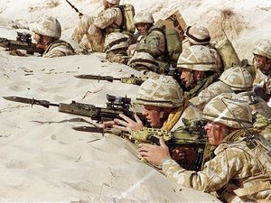 """British soldiers from the First Stafford, well known as the """"Desert Rats"""", stand in a trench in January 1991 somewhere in Saudi desert"""