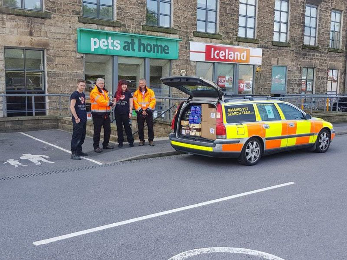 Members of Animal Search UK rescue animals from Whaley Bridge