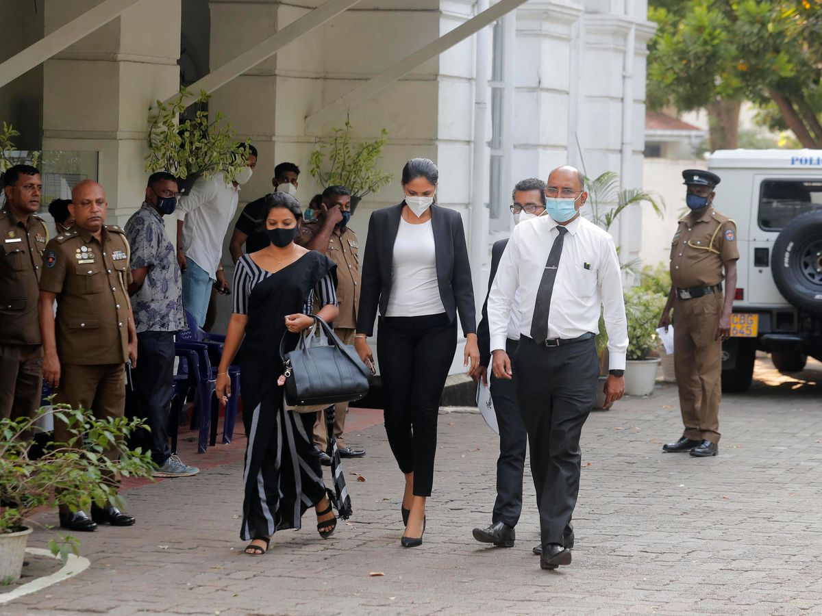 Caroline Jurie leaves a police station after being bailed in Colombo, Sri Lanka
