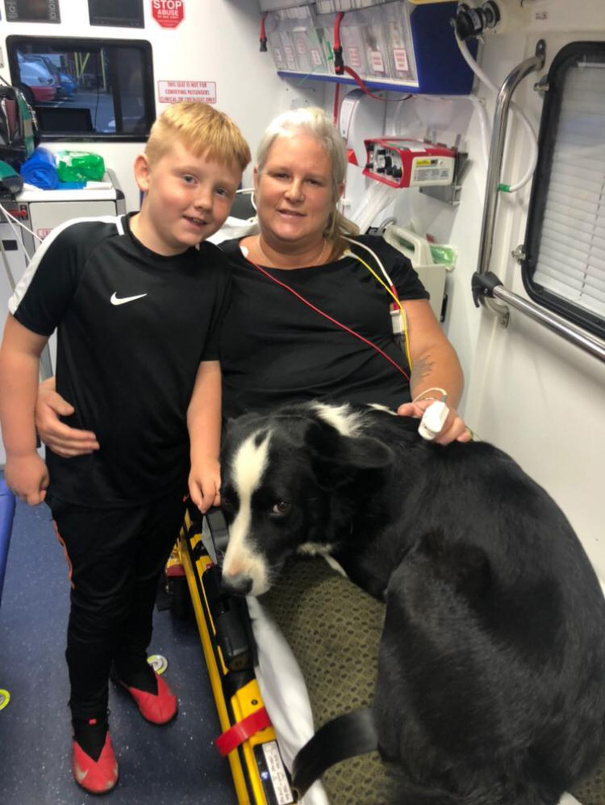 Jakob and mum Sally in the ambulance with Drift the Border Collie