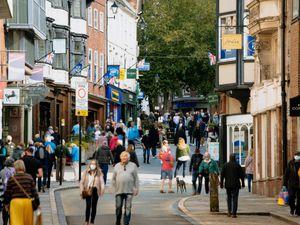 Pedestrians on the corner of Shoplatch and High Street in Shrewsbury