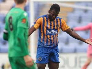James Roberts of Oxford City reacts on the floor after a challenge from Aaron Pierre of Shrewsbury Town which results in a red card from both players.