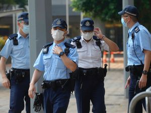 Police await Tong Ying-kit's arrival at court