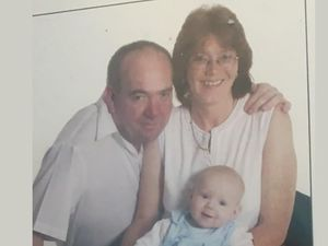 Yvonne Booth with her late husband and her son