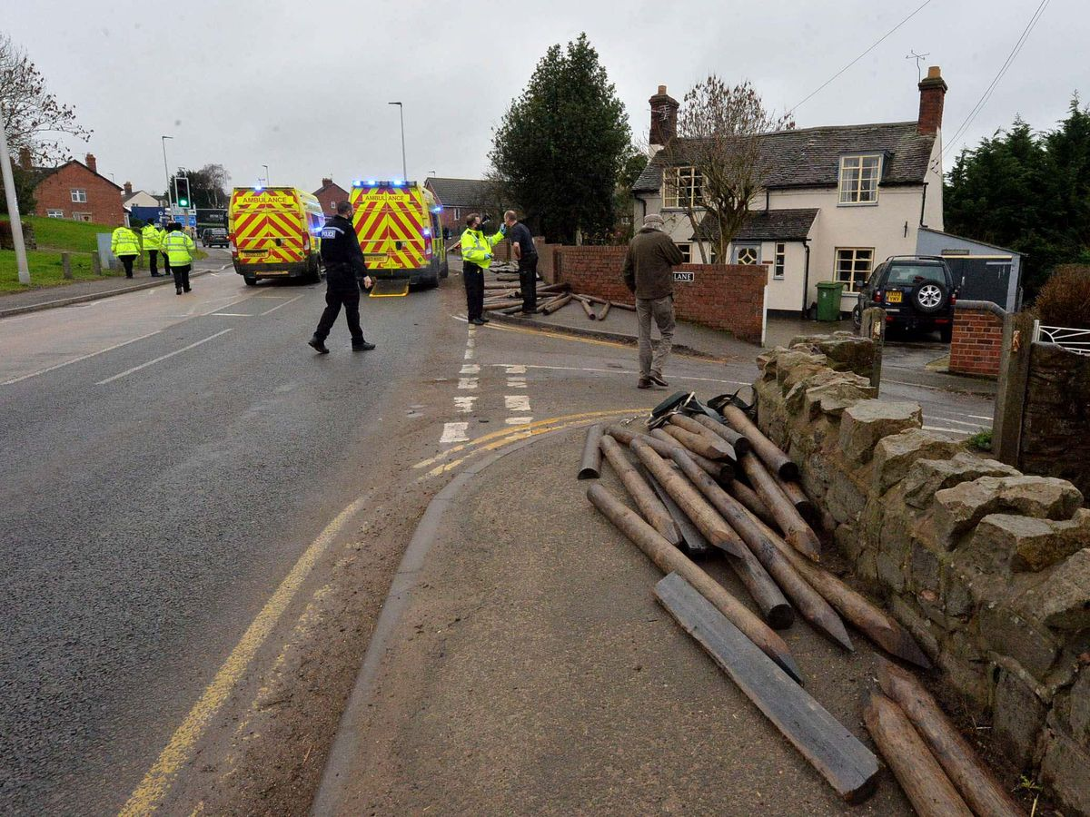 Timber fell from a lorry, injuring two people