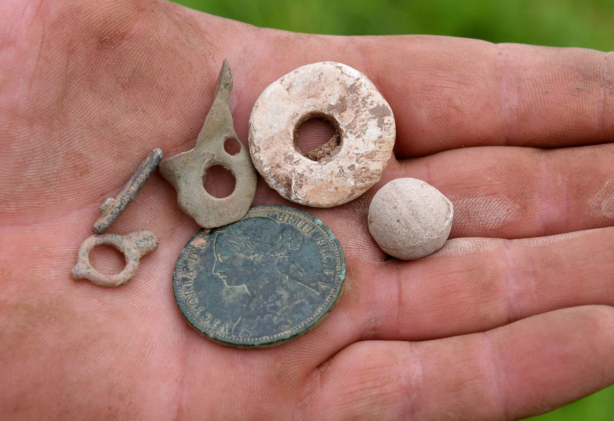 Objects including a watch winder, a musket ball, a spindle worl and Victoria penny were discovered