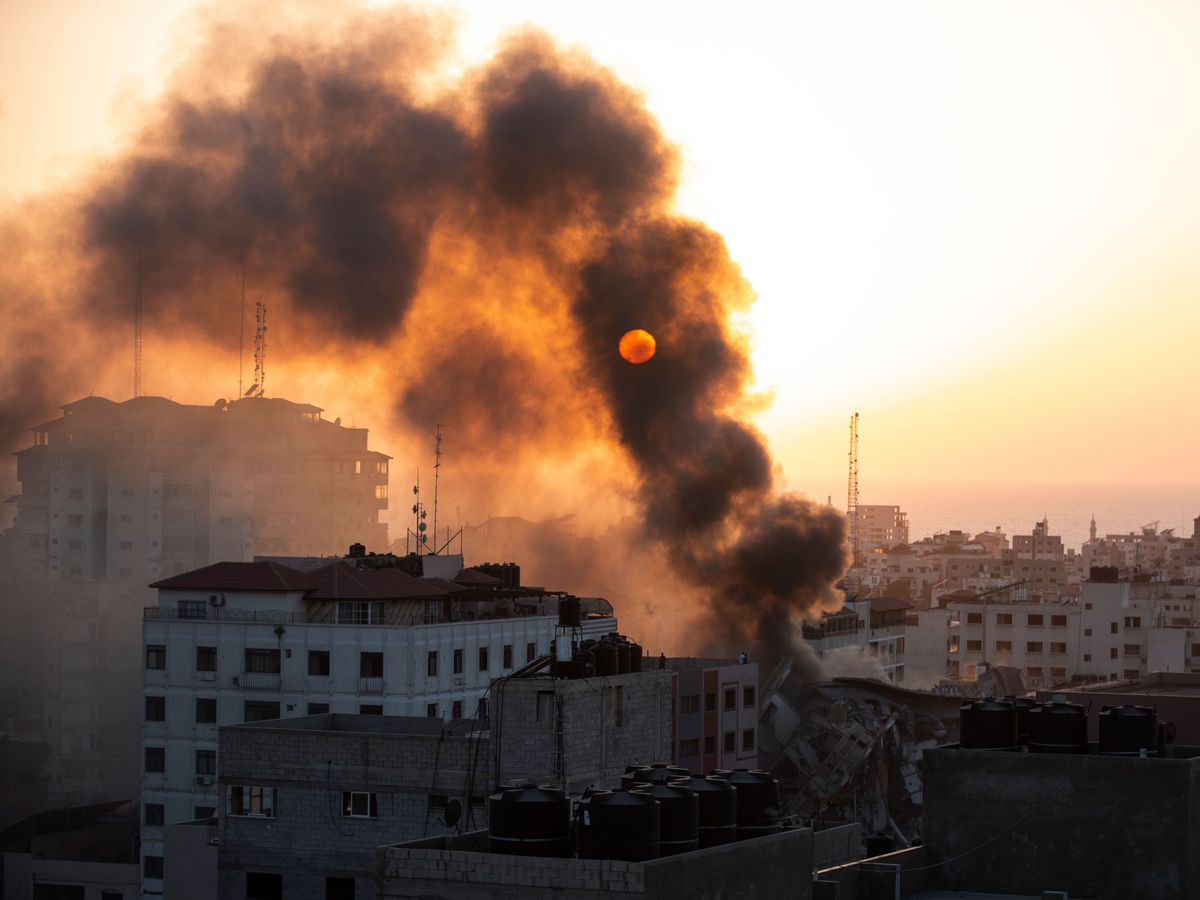Smoke is seen from a collapsed building after it was hit by Israeli airstrikes on Gaza City