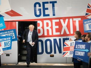 Boris Johnson next to the slogan 'Get Brexit Done' on the Tory election battlebus