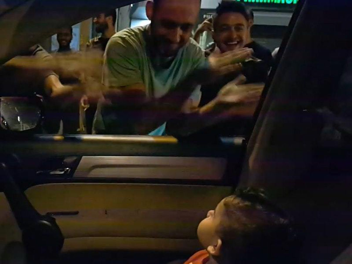 Protesters sing Baby Shark to a toddler in a car