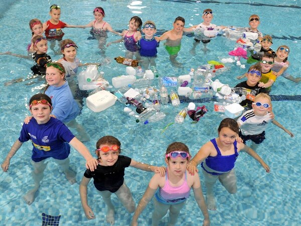 Children learning to swim . . . and save the planet